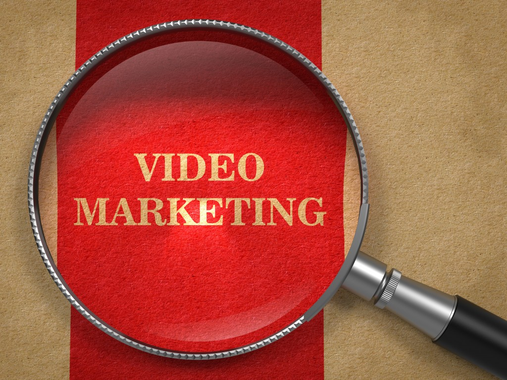 Video Marketing Concept Through Magnifying Glass.